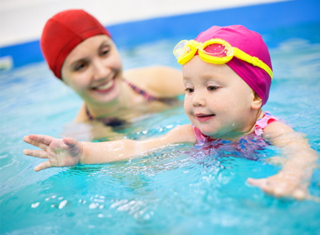 stock-photo-healthy-family-mother-teaching-baby-swimming-pool-457674580