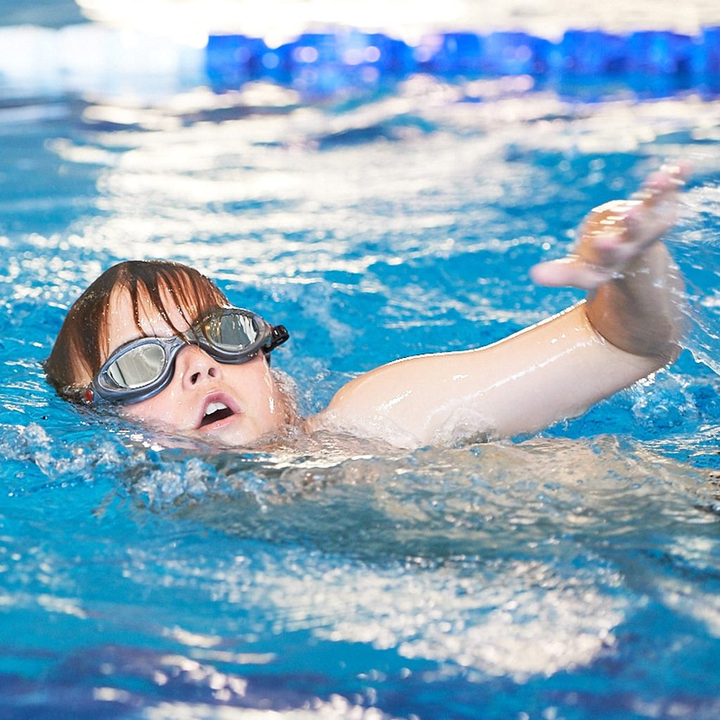 small child swimming