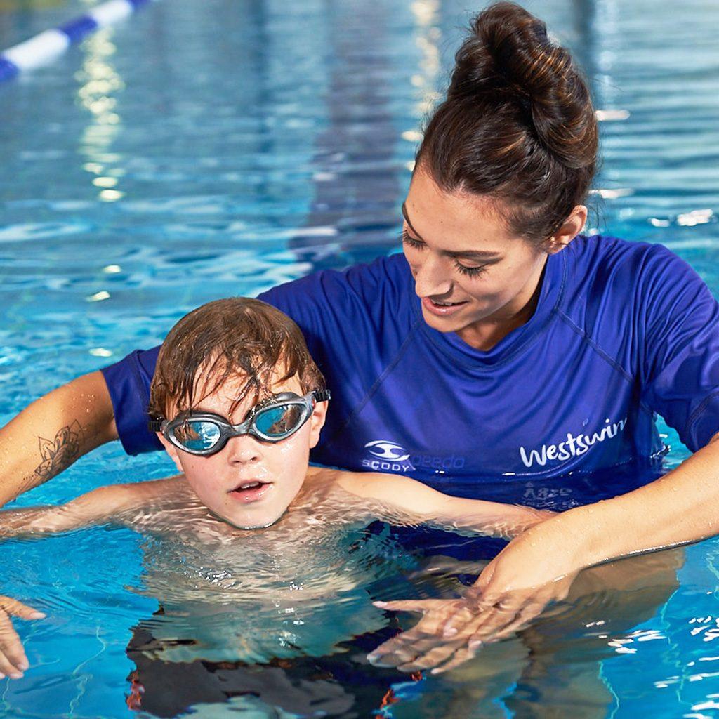 child learning to swim